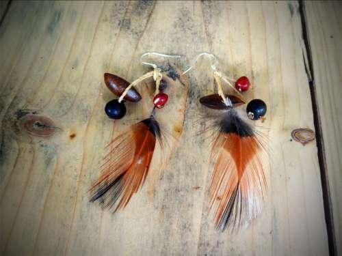 Boucles d'oreilles «Plume claire»